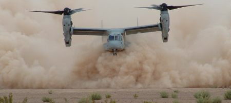 Image: A Boeing V-22 Osprey near the ground showing the dust cloud from rotor downwash which can lead to brownout conditions.
